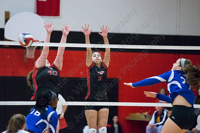 Cheshire's Meagan Clyne blocks Glastonbury's Victoria Hurley Saturday during the CIAC Class LL quarterfinals at Cheshire High School in Cheshire November 11, 2017 | Justin Weekes / For the Record-Journal