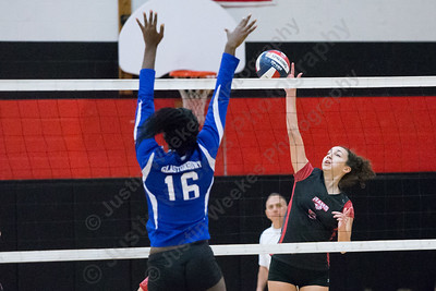 Cheshire's Elena Piran gets a spike off for a kill Saturday during the CIAC Class LL quarterfinals at Cheshire High School in Cheshire November 11, 2017 | Justin Weekes / For the Record-Journal