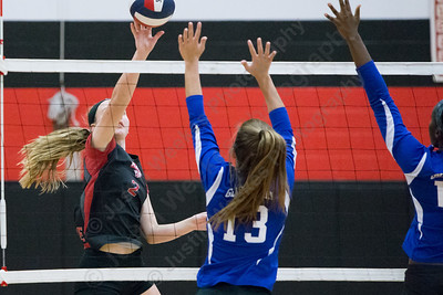 Cheshire's Mia Juodaitis touches over Glastonbury blockers Saturday during the CIAC Class LL quarterfinals at Cheshire High School in Cheshire November 11, 2017 | Justin Weekes / For the Record-Journal
