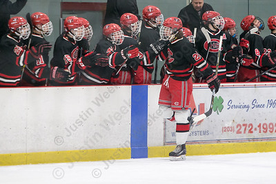 Cheshire's James Ilnicki celebrates with the bench after scoring in a game with Lyman Hall Tuesday at the Northford Ice Pavilion in Northford December 19, 2017 | Justin Weekes / For the Record-Journal