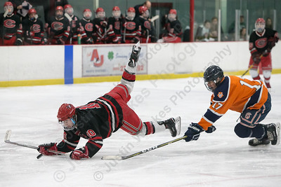 Cheshire's Dylan Clark gets tripped up by Lyman Hall's Jared Sullivan Tuesday at the Northford Ice Pavilion in Northford December 19, 2017 | Justin Weekes / For the Record-Journal