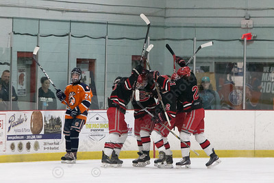 Cheshire's celebrates getting on the board first 16 seconds into the game with a goal from Evan Veivia Tuesday at the Northford Ice Pavilion in Northford December 19, 2017 | Justin Weekes / For the Record-Journal