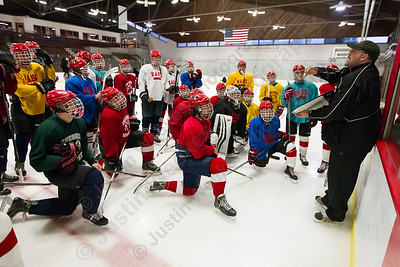 Cheshire's head coach Anthony Giusto talks with players Monday during practice at Wesleyan University in Middletown December 11, 2017 | Justin Weekes / For the Record-Journal