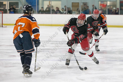 Cheshire's James Ilnicki gets a shot off Tuesday at the Northford Ice Pavilion in Northford December 19, 2017 | Justin Weekes / For the Record-Journal