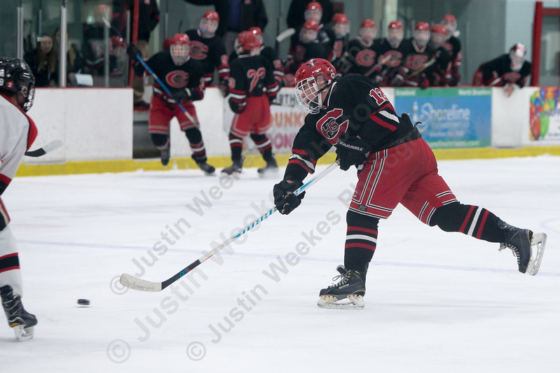 Cheshire's Kyle Sheehan gets a shot off Saturday at the Northford Ice Pavilion in Northford February 3, 2018 | Justin Weekes / Special to the Record-Journal