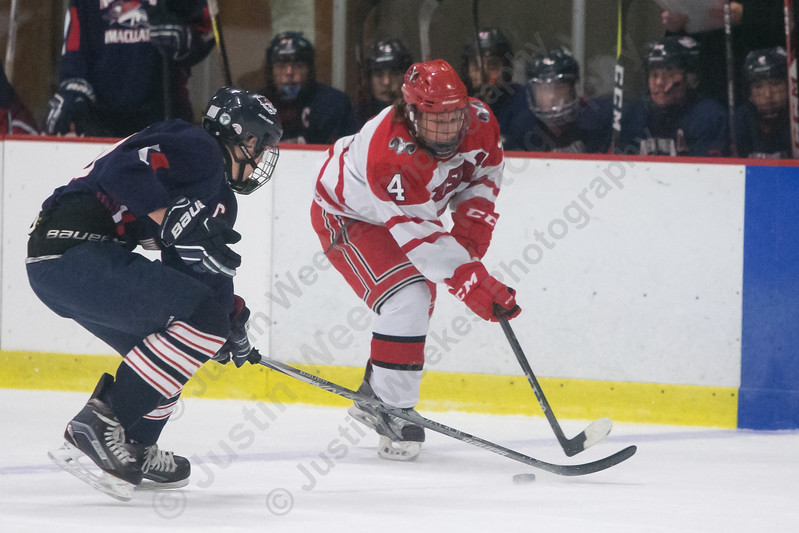 Cheshire's Kyle Letourneau gains the zone as NFI Matthew Carlucci defends Monday at Spurrier-Snyder Rink on the campus of Wesleyan University in Middletown January 22, 2018 | Justin Weekes / Special to the Record-Journal
