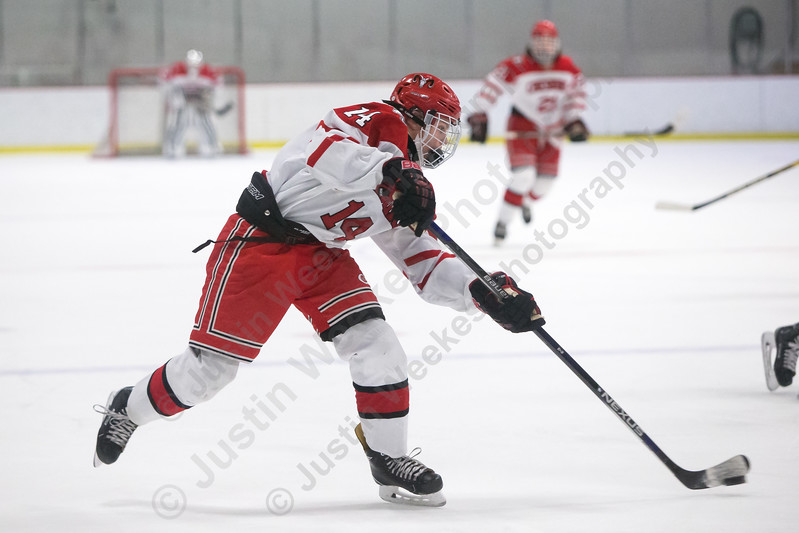 Cheshire's Niklas Vasiljevs gets a shot on net Monday at Spurrier-Snyder Rink on the campus of Wesleyan University in Middletown January 22, 2018 | Justin Weekes / Special to the Record-Journal