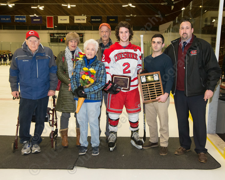 Cheshire's senior captain Sawyer Hackett received the Schena-Whitlock Award during a pregame ceremony with the Schena and Whitlock family Monday at Spurrier-Snyder Rink on the campus of Wesleyan University in Middletown January 22, 2018   Justin Weekes / Special to the Record-Journal