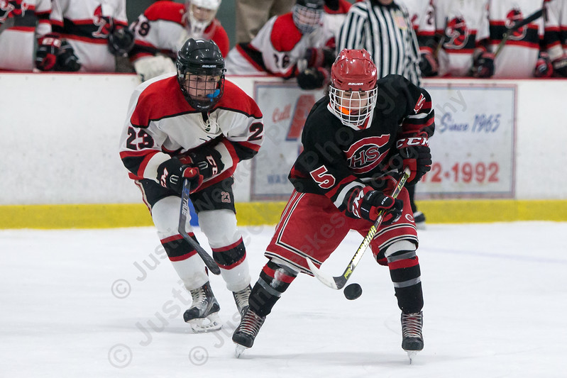 Cheshire's Lorenzo Ocone-Krause tries to settle the puck Saturday at the Northford Ice Pavilion in Northford February 3, 2018 | Justin Weekes / Special to the Record-Journal