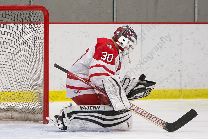 Cheshire's goalie Nicholas Maringola gloves a save Wednesday at the Spurrier-Snyder Rink on the campus of Wesleyan University in Middletown January 3, 2018 | Justin Weekes / Special to the Record-Journal