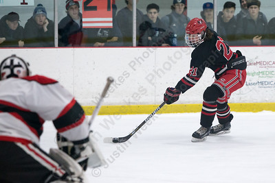 Cheshire's James Ilnicki gets a back handed shot on goal Saturday at the Northford Ice Pavilion in Northford February 3, 2018 | Justin Weekes / Special to the Record-Journal