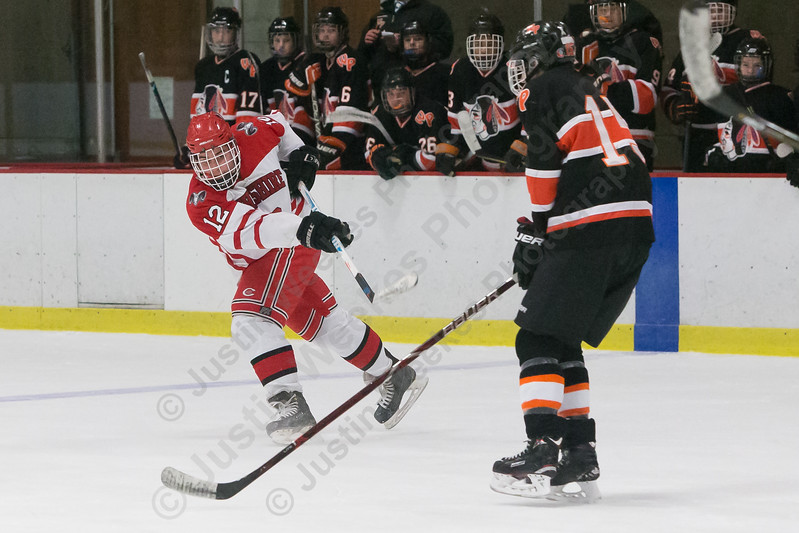 Cheshire's Kyle Sheehan gets a shot off from the point Wednesday at the Spurrier-Snyder Rink on the campus of Wesleyan University in Middletown January 3, 2018 | Justin Weekes / Special to the Record-Journal