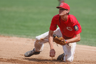 Cheshire's Joe Anderson (10) looks to first after diving to stop a hit during a game with RCP Saturday at Cubeta Stadium in Stamford August,2 2014 | Justin Weekes / For the Record-Journal