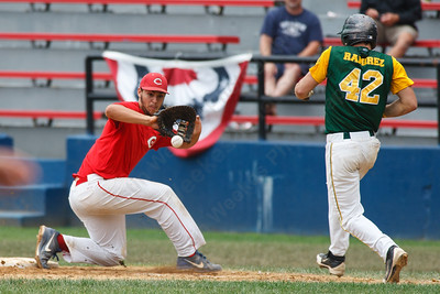 Cheshire's Mike Purcell (27) corrals a throw to first to get  RCP's Alex Ramirez (42) out Saturday at Cubeta Stadium in Stamford August,2 2014 | Justin Weekes / For the Record-Journal