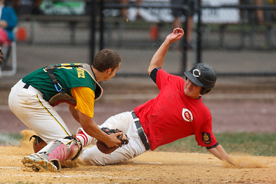 Cheshire's Jonathon Koski (5) beats the tag at home from RCP's Kevin Radziewicz (7) Saturday at Cubeta Stadium in Stamford August,2 2014 | Justin Weekes / For the Record-Journal