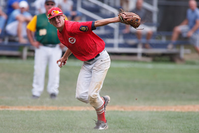 Cheshire's Jonathon Koski (5) eyes first base after fielding a bunt during a game with RCP Saturday at Cubeta Stadium in Stamford August,2 2014 | Justin Weekes / For the Record-Journal