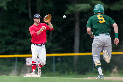 Cheshire's Cooper Mrowka (9) gets the toss for the force on Hamden's Luke D'Ostilio (5) at second Wednesday at Cheshire High School in Cheshire Jul. 22, 2015 | Justin Weekes / For the Record-Journal
