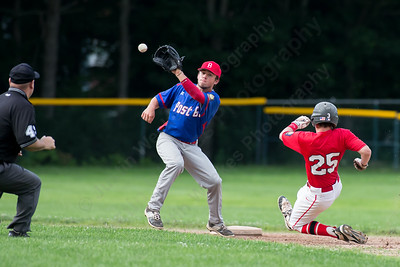 Cheshire's Jason Strollo (25) beats the tag into second from Berlin's Hunter Tralli (19) Wednesday at Cheshire High School in Cheshire Jul. 8, 2015 | Justin Weekes / For the Record-Journal