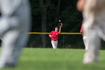 Cheshire's Luciano Gaudio (18) brings in a fly ball Wednesday at Cheshire High School in Cheshire Jul. 8, 2015 | Justin Weekes / For the Record-Journal