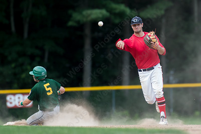 Cheshire's Cooper Mrowka (9) throws to first after the force on Hamden's Luke D'Ostilio (5) at second Wednesday at Cheshire High School in Cheshire Jul. 22, 2015 | Justin Weekes / For the Record-Journal