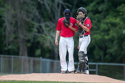 Liam Davey gets an update from catcher Wes Robertson Saturday during the first round of the State tournament with Stamford at Palmer Field in Middletown Jul. 25, 2015 | Justin Weekes / For the Record-Journal