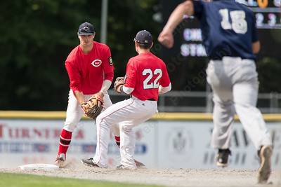 Cheshire's Cooper Mrowka (9) tosses to Altrin Kabashi (22) for the force at second Saturday during the first round of the State tournament at Palmer Field in Middletown Jul. 25, 2015 | Justin Weekes / For the Record-Journal
