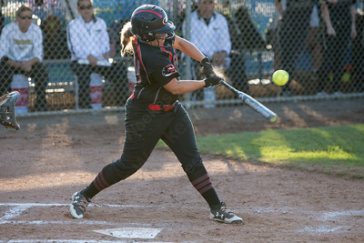 Cheshire's Alexis Hemstock drives in a run to make it 2-0 Rams in the first inning Monday during the CIAC Class LL semifinals at West Haven High School in West Haven June 4, 2018 | Justin Weekes / Special to the Record-Journal