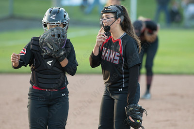 Cheshire's Jade Barnes visits Natalie Amato at the mound Monday during the CIAC Class LL semifinals at West Haven High School in West Haven June 4, 2018 | Justin Weekes / Special to the Record-Journal