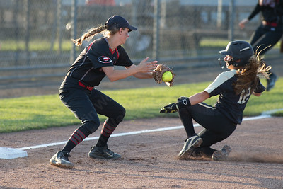 Cheshire's Brianna Floyd tries to tag out Trumbull's Maggie Coffin Monday during the CIAC Class LL semifinals at West Haven High School in West Haven June 4, 2018 | Justin Weekes / Special to the Record-Journal