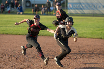 Cheshire's Mia Juodiatis tags out Trumbull's Julia Huzi Monday during the CIAC Class LL semifinals at West Haven High School in West Haven June 4, 2018   Justin Weekes / Special to the Record-Journal