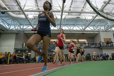 Cheshire's Lauren Daddi paces Hillhouse's De' Janay Davis in the 4x800 Friday during the Indoor Track Finals at the Floyd Little Athletic Center in New Haven February 2, 2018 | Justin Weekes / Special to the Record-Journal
