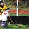 10/25/2009...Northern Highland's senior Kristin Heaney (4) scoring one of her five goals past Old Tappan keeper Emily Moran (41), and had two assists in the Highlander's 7-4 semifinal win over the Golden Nights.<br /> PHOTO: KELLY BIRDSEYE