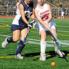 10/25/2009...Northern Highland's Kelsey Dow (25) and Alicia Pietro of  Old Tappan vie for the ball in the Highlander's 7-4 semifinal win over the Golden Nights.<br /> PHOTO: KELLY BIRDSEYE
