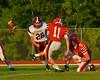 Baldwinsville Bees Tom Scarfino (11) kicks an extra point against the Auburn Maroons at Pelcher-Arcaro Stadium in Baldwinsville, New York on Friday, September 5, 2014. Baldwinsville won 30-8.