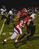 Baldwinsville BeesRyan Ingerson (23) lowers a shoulder in a Fayetteville-Manlius Hornets defender at Pelcher-Arcaro Stadium in Baldwinsville, New York on Friday, September 26, 2014. Baldwinsville won 39-6.
