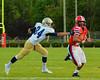 Baldwinsville Bees Cameron Skipworth (22) avoids West Genesee Wildcats defender Justin Huppmann (84) to score a touchdown at Pelcher-Arcaro Stadium in Baldwinsville, New York on Friday, September 12, 2014. Baldwinsville won 36-7.