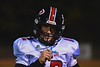 Utica-Proctor Raiders Quarterback Logan Wilcox (12) gets the play from the sideline against the Baldwinsville Bees in Section III Football action at the Pelcher-Arcaro Stadium in Baldwinsville, New York on Friday, October 2, 2015. Baldwinsville won 35-34.