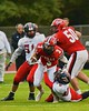 Baldwinsville Bees Jack Buis (3) running through Utica-Proctor Raiders defenders in Section III Football action at the Pelcher-Arcaro Stadium in Baldwinsville, New York on Friday, October 2, 2015. Baldwinsville won 35-34.