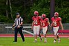 Baldwinsville Bees captains Danny Bridge (50), Brandon Schmid (8) and Mike Spicer (76) walk out for the coin toss before playing the Utica-Proctor Raiders in Section III Football action at the Pelcher-Arcaro Stadium in Baldwinsville, New York on Friday, October 2, 2015. Baldwinsville won 35-34.