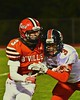 Baldwinsville Bees Jack Buis (3) bets blocked by a Utica-Proctor Raiders defender in Section III Football action at the Pelcher-Arcaro Stadium in Baldwinsville, New York on Friday, October 2, 2015. Baldwinsville won 35-34.