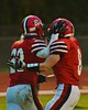 Baldwinsville Bees Ryan Ingerson (23) is congratulated by teammate Brandon Schmid (8) after scoring a touchdown against the Utica-Proctor Raiders in Section III Football action at the Pelcher-Arcaro Stadium in Baldwinsville, New York on Friday, October 2, 2015. Baldwinsville won 35-34.