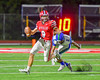 Baldwinsville Bees Ben Dwyer (9) escapes from Cicero-North Syracuse Northstars Omar Mere (2) in Section III Football action at the Pelcher-Arcaro Stadium in Baldwinsville, New York on Friday, October 7, 2016. Cicero-North Syracuse won 20-7.
