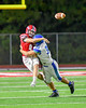 Baldwinsville Bees Ben Dwyer (9) gets the ball away before being tackled by Cicero-North Syracuse Northstars Kyle Cody (35) in Section III Football action at the Pelcher-Arcaro Stadium in Baldwinsville, New York on Friday, October 7, 2016. Cicero-North Syracuse won 20-7.