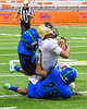 Christian Brothers Academy SirVocea Dennis (17) is tackled by Cicero-North Syracuse Northstars defenders Omar Mere (2) and Josh Lawrence (23)in Section III Class AA Football Championship action at the Carrier Dome in Syracuse, New York on Saturday, November 5, 2016. CBA won 27-14.