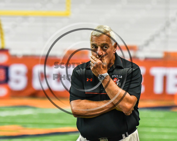 Baldwinsville Bees Head Coach Carl Sanfilippo pacing the sidelines before the game against the Corning Hawks in the 2017 Kick Off Classic at the Carrier Dome in Syracuse, New York on Thursday, August 31, 2017.  Baldwinsville won 35-7.
