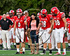 Baldwinsville Bees captains Ben Dwyer (9), Cameron Majchrzak (78) and Gabe Horan (88) and special guest walk out for the coin toss with the Liverpool Warriors in Section III Football action at the Pelcher-Arcaro Stadium in Baldwinsville, New York on Friday, September 22, 2017.