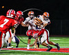 Liverpool Warriors Cade Clouthier (6) gets tackled by Baldwinsville Bees EJ Edmonds (23) in Section III Football action at the Pelcher-Arcaro Stadium in Baldwinsville, New York on Friday, September 22, 2017.  Baldwinsville won 35-7.