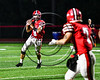 Baldwinsville Bees Ben Dwyer (9) looking to make a pass against the Liverpool Warriors in Section III Football action at the Pelcher-Arcaro Stadium in Baldwinsville, New York on Friday, September 22, 2017.  Baldwinsville won 35-7.