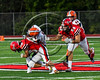 Liverpool Warriors Kaleb Ohlemacher (5) is tackled by Baldwinsville Bees Patrick May (86) in Section III Football action at the Pelcher-Arcaro Stadium in Baldwinsville, New York on Friday, September 22, 2017. Baldwinsville won 35-7.