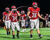 Baldwinsville Bees Cameron Majchrzak (78), Michael Letizia (34) and EJ Edmonds (23) come on to the field to play defense the Liverpool Warriors in Section III Football action at the Pelcher-Arcaro Stadium in Baldwinsville, New York on Friday, September 22, 2017.  Baldwinsville won 35-7.